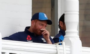 Jonny Bairstow watches from the dressing-room balcony after fracturing the middle finger of his left hand on day three at Trent Bridge.