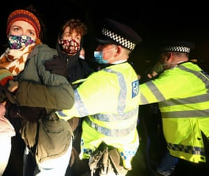 Police clashed as they moved to disperse the crowd that had gathered to pay tribute to Sarah Everard.