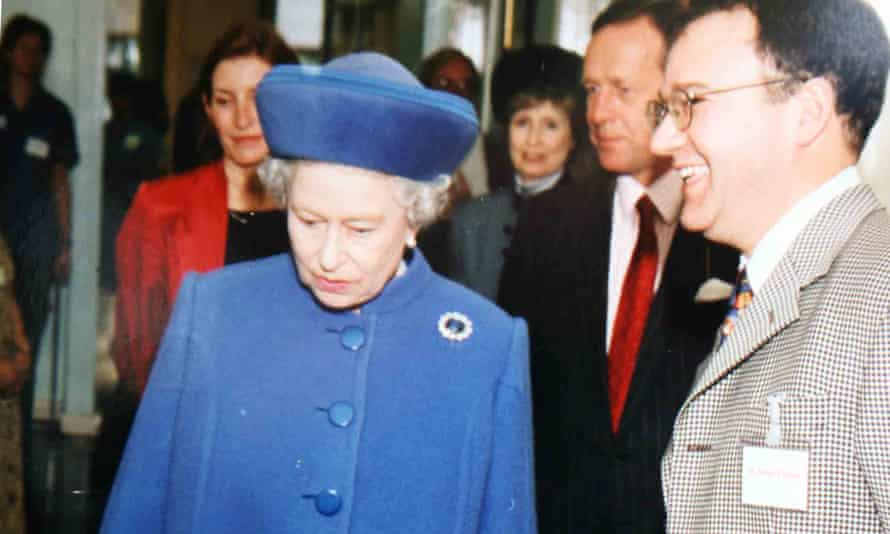 Peter Fisher, right, pictured with the Queen