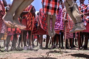 Men from the Maasai tribe perform a traditional jumping ritual as they observe a rite of passage to mark the transition to cultural junior elder within the Masai-Mara national reserve.