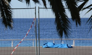 The body of a victim lies covered on Promenade des Anglais following the truck attack that claimed dozens of lives.