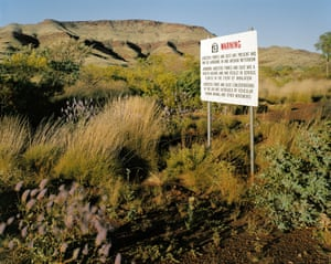 The entrance to Wittenoom. The government has erected notices warning of the dangers of asbestos but has done nothing to prevent access by the public to the exposed asbestos tailings. Wittenoom, August 1999. From the series Asbestos (detail), 1999