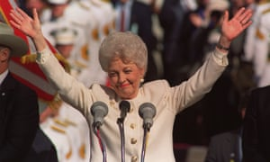 Ann Richards raises both arms in celebration after being sworn in as governor of Texas in Austin, Texas in this Jan. 15, 1991