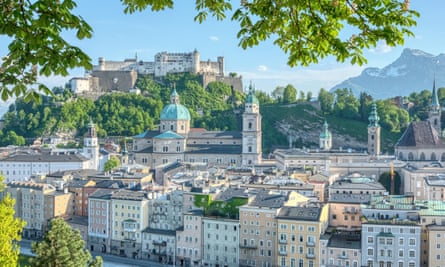 View of the city of Salzburg, Austria, with the castle and the Alps in the background