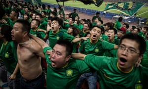 Fans of Beijing Guoan celebrate a goal.