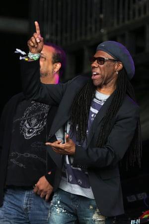 US musician and producer Nile Rodgers watches British singer Barry Gibb's performance