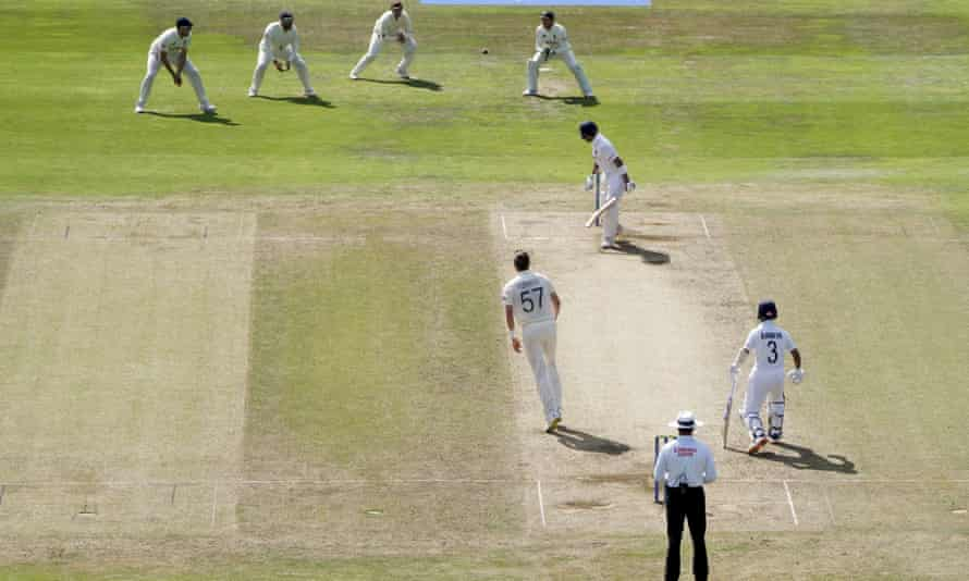 The England captain, Joe Root, prepares to take the catch to dismiss his opposite number, Virat Kohli, from the bowling of Ollie Robinson