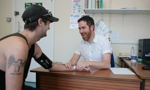 Dr Tim Worthley with a patient at his Arch Healthcare surgery in Brighton.