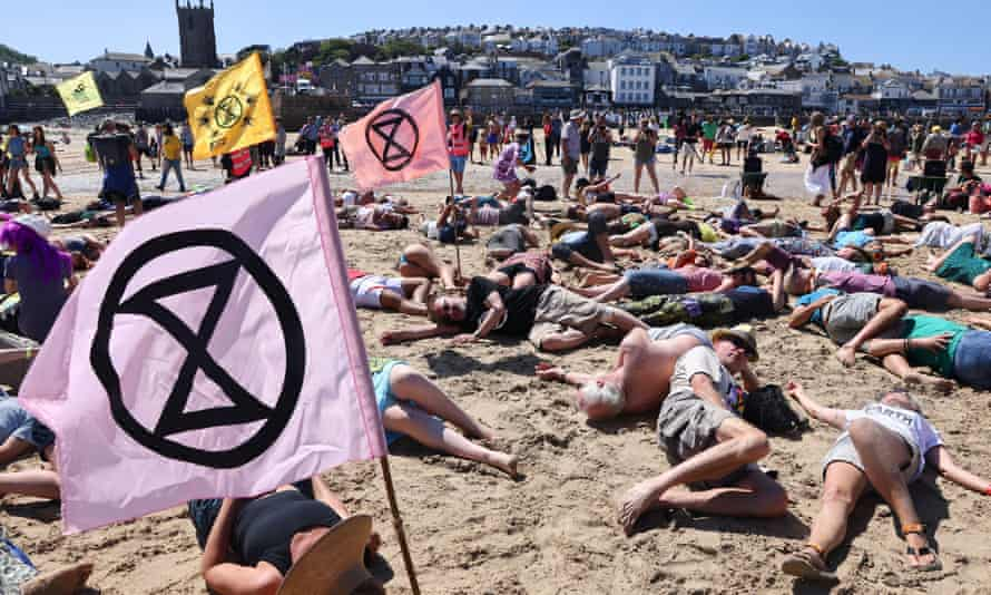 Extinction Rebellion protesters protest on St Ives beach during the G7 summit in Cornwall.