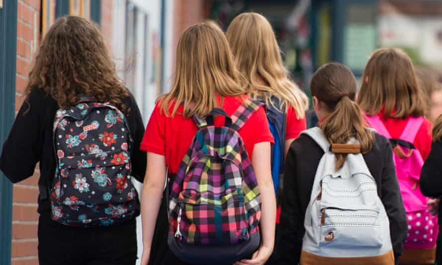 A group of young people wearing backpacks