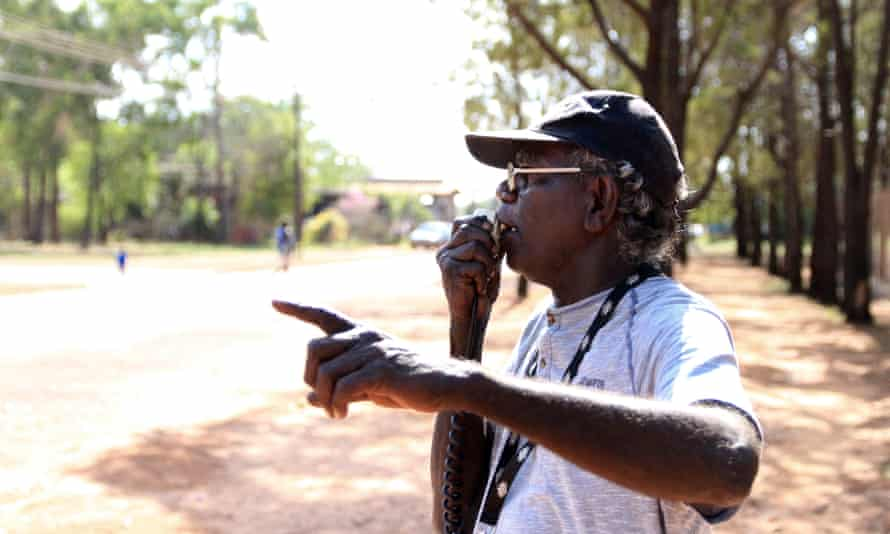 Maningrida community leader Baru Pascoe walks the streets with a megaphone urging people to come to a meeting with the royal commission into the protection and detention of children in the Northern Territory.