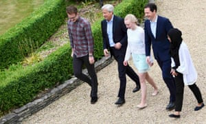 Jamie Dimon, second from left, with staff and George Osborne this month during a visit to JP Morgan's corporate centre in Bournemouth.