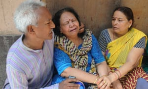 Relatives mourn the death of 11 members of a family that were found dead in on Sunday in north Delhi.