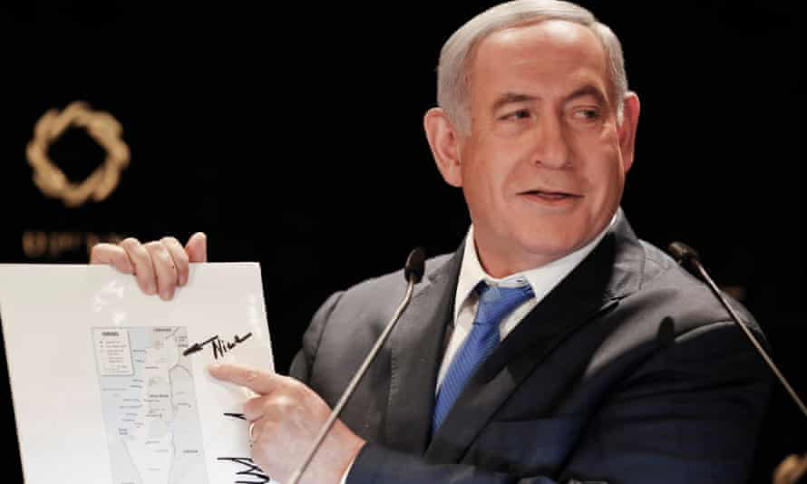 Benjamin Netanyahu points to the Golan Heights' inclusion on a map of Israel featuring a comment by Donald Trump after meeting his son-in-law, Jared Kushner.