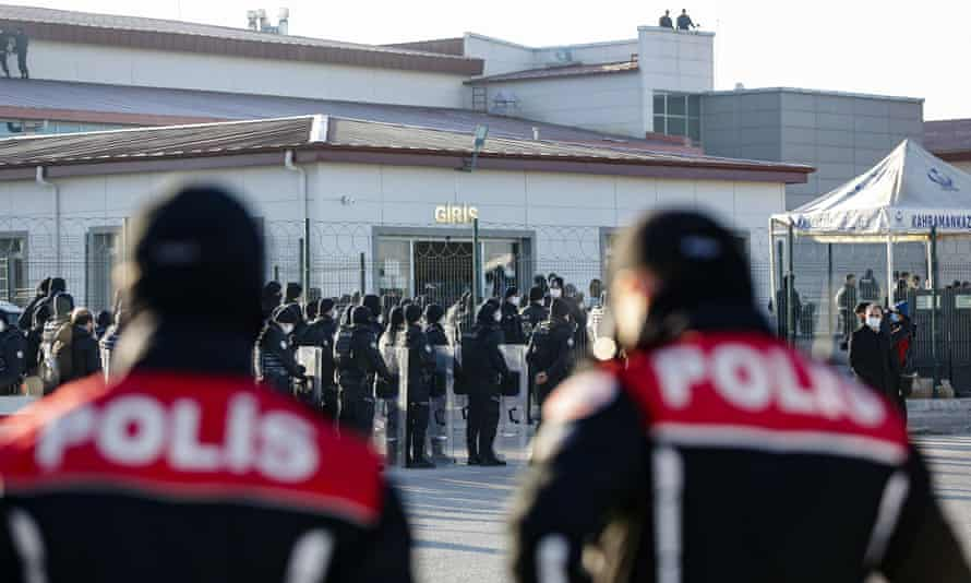 Police officers stand guard at the entrance of the Sincan penal institution at the 4th heavy penal court near Ankara