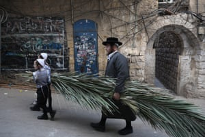Jerusalem, Israel An ultra-Orthodox Jewish man carries palm branches, used during the celebration of Sukkot, the Feast of the Tabernacles, in the ultra-Orthodox neighbourhood of Mea Shearim. The Sukkot feast begins on 13 October at sunset and ends on 20 October. It commemorates the exodus of Jews from Egypt some 3,200 years ago