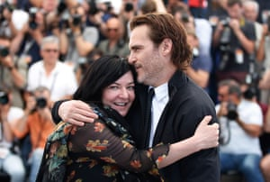 Joaquin Phoenix and director Lynne Ramsay pose during the photocall for You Were Never Really Here