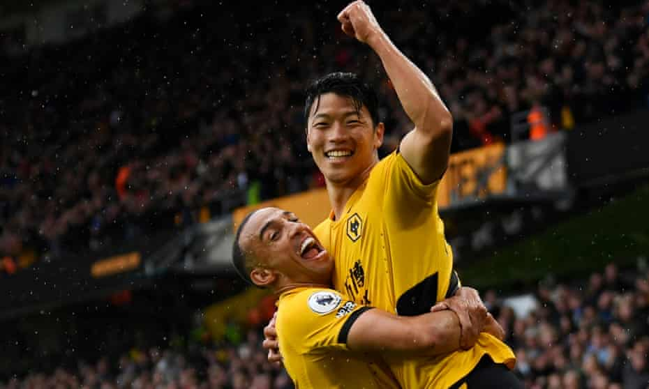 Hwang Hee-Chan celebrates his second goal with Marcal.
