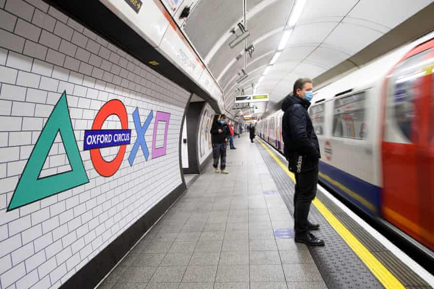 Signs at Oxford Circus underground station, in London, last November promote the UK launch of PlayStation 5.