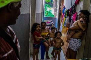 Children and adults in a squat in Gamboa, Rio