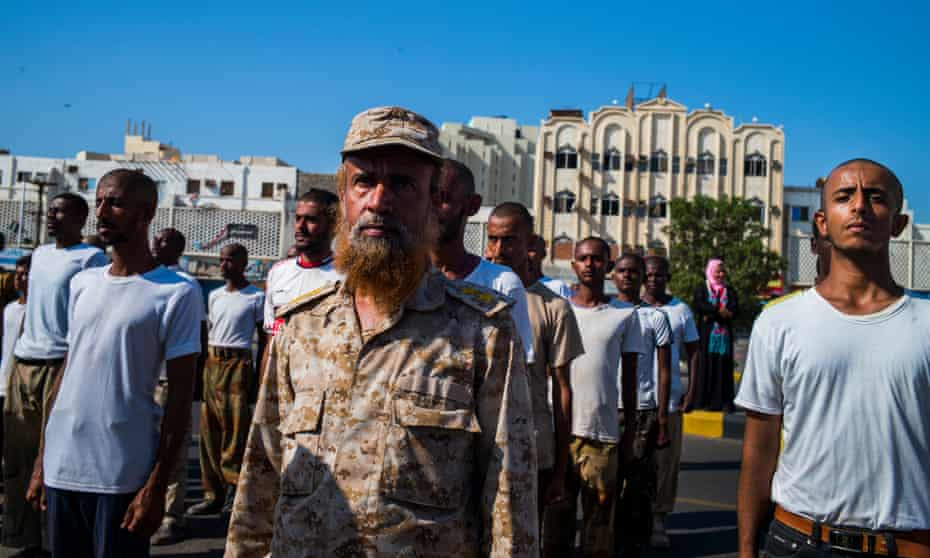 Pro Government, resistance fighter duling Independance day military prade, new recruits are trained by an old officer from the former South Yemen Army. By Ghaith Abdulahad