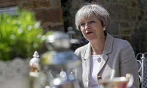Theresa May listens to members of the public during a general election campaign tour stop at Pot House Hamlet in Silkstone, on 3 June.