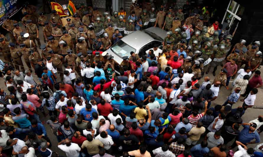 A crowd gathers outside the state-run Ceylon Petroleum Corporation office in Colombo, where the shooting took place