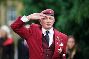 A veteran of the parachute regiment salutes in Falmouth, Cornwall