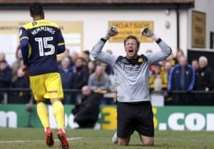 Merstham keeper Phil Wilson shows his frustration after Oxford United forward Kane Hemmings scores to make it 5-0.