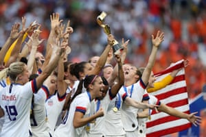 Carli Lloyd of the USA lifts the FIFA Women's World Cup trophy following her team's victory over Netherlands.