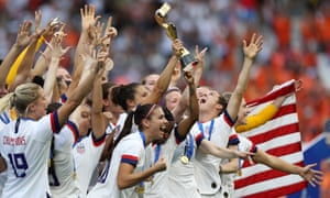 Carli Lloyd raises the trophy after the USWNT wins the Women's World Cup in Lyon, France, on 7 July 2019.
