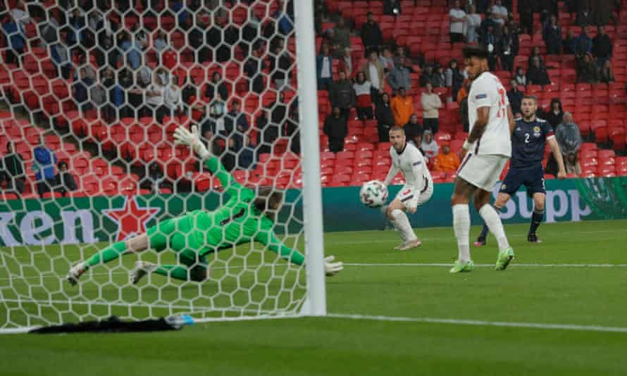 Jordan Pickford saves well from Stephen O'Donnell in the first half at Wembley.
