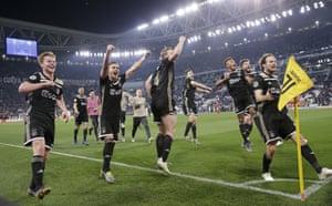 Ajax players celebrate their 2-1 win over Juventus.