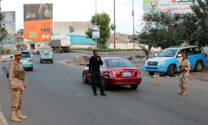 Members of Aden's police force at a checkpoint in the Yemeni city.