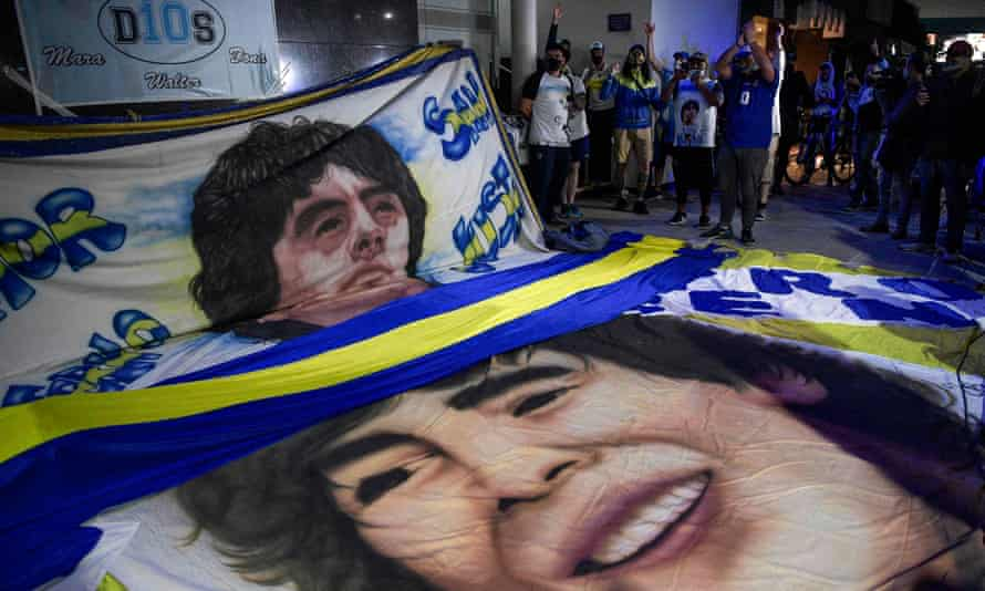Supporters of Diego Maradona gather outside the hospital where he had brain surgery.
