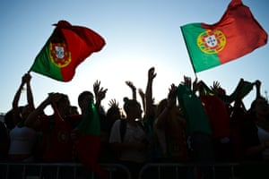 Portugal faced Wales in the first semi-final in Lyon. Here, fans wave flags in Lisbon before the start of the match