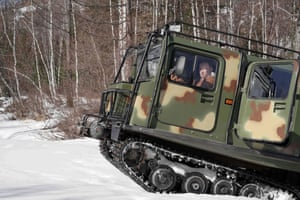 The Russian president takes a drive through Siberian woodland.