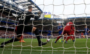Chelsea's César Azpilicueta (centre) bundles the ball into the Liverpool net, but the goal was ruled out.