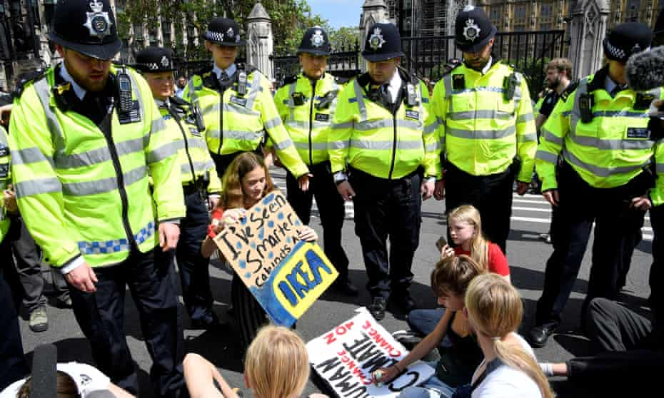 Police in London, this May, with climate crisis demonstrators.