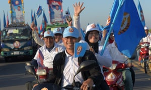 The Cambodian People's Party (CPP) has held power for 32 years. Here supporters ride their motorbikes on the last day of the commune election campaign.