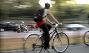 Women rides in cycle lane in London