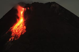Lava flows down from the crater of Mount Merapi as its activity continues, in Pakem, Hargobinangun, Yogyakarta
