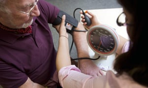 A man has his blood pressure tested
