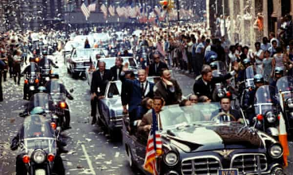 The returning Apollo 11 crew, Buzz Aldrin, Michael Collins and Neil Armstrong, seen left to right in the lead car, are showered in ticker tape during a parade down Broadway and Park Avenue in New York, on 13 August 1969.