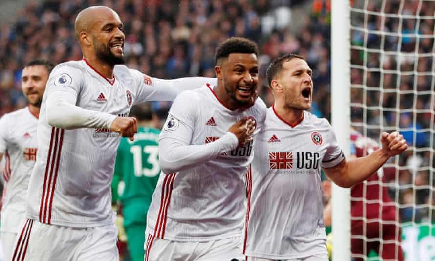 Lys Mousset celebrates scoring Sheffield United's leveller against West Ham United with teammates.