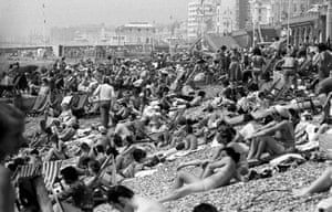 Sunbathers on a crowded Brighton beach