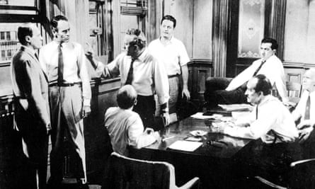 A scene from Sidney Lumet's 1957 courtroom drama 12 Angry Men, in which an individual (Henry Fonda) challenges the majority view.