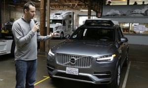 Anthony Levandowski, head of Uber's self-driving program, speaks about their driverless cars in San Francisco. An Otto self-driving truck can be seen in the background.