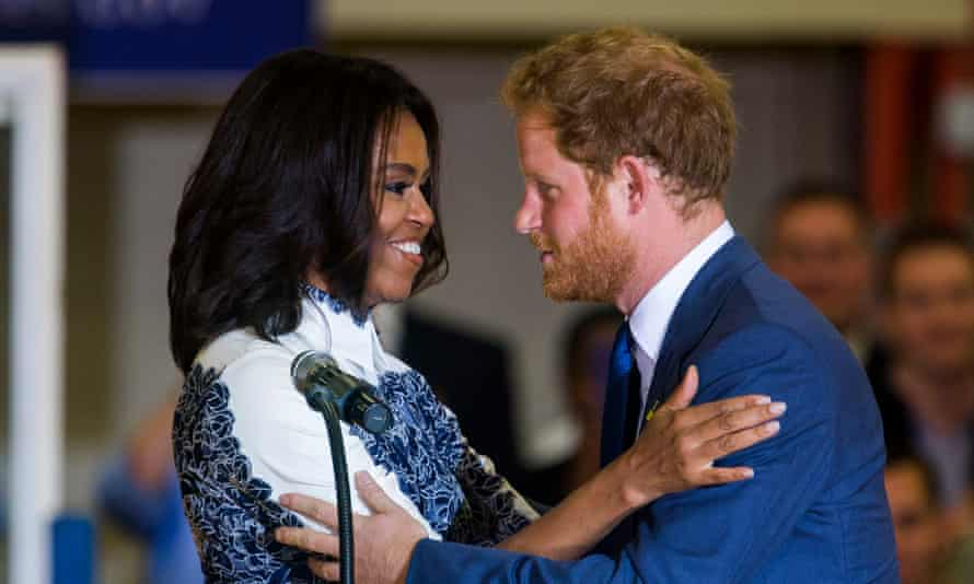 The first lady and Prince Harry embrace during an event for US veterans last year in Virginia.