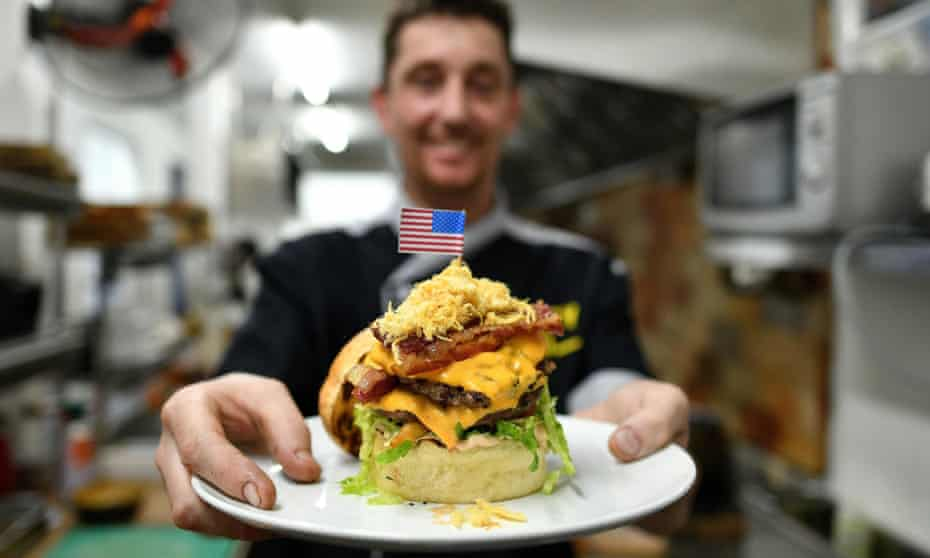 Head chef Colin Kelly displays a Durty Donald burger.